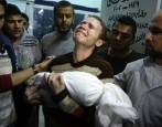 Photo: Jihad Misharawi, BBC Arabic Correspondent, carries his son's body at a Gaza hospital. (AP) TAKE ACTION FOR GAZA: Stop the bombs, stop the siege, stop the blank check [November...